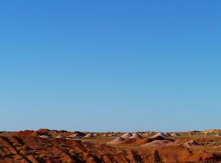 molehill: The Coober Pedy opal mining fields at sunrise in South Australia