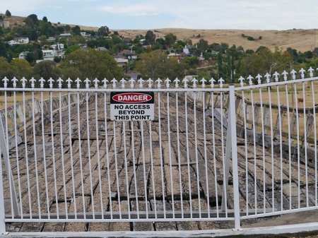 A safety fence on the ancient Prince Alfred Bridge over the Murrumbidgee floodplain in Gundagai in Australia