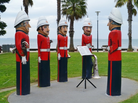 The humorous painted wood bollards at the waterfront of Geelong in Victoria in Australia