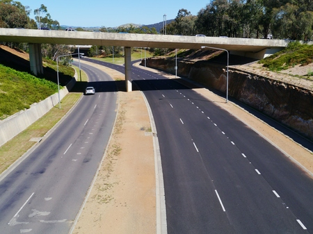 encircling: The ring road beltway or loop is the road encircling Canberra in Australia