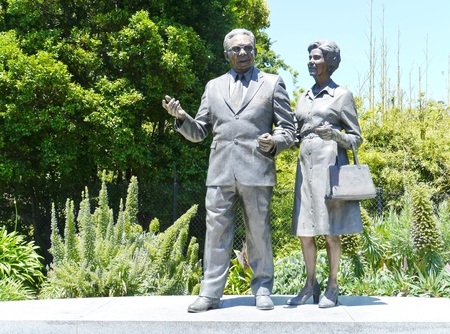 pioneering: Statue of pastor sir douglas and lady gladys Nicholls  in Parliament Gardens in Melbourne in Australia