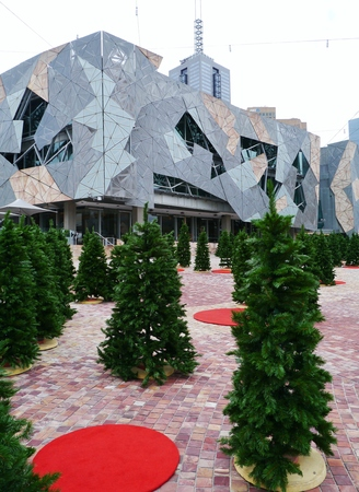 fronts: Federation square in Melbourne in Australia with artificial green christmas trees in summer