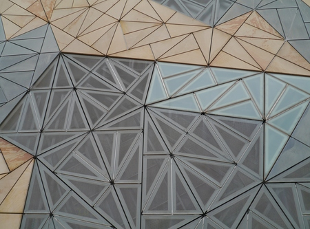 view of an atrium in a building: A detail of the building of the Australian centre for moving image on Faderation square in Melbourne in Australia