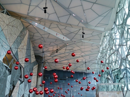 view of an atrium in a building: Federation square with red Christmas balls  in Melbourne in Victoria in Australia