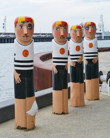 bollards: The humorous painted wood bollards at the waterfront of Geelong in Victoria in Australia