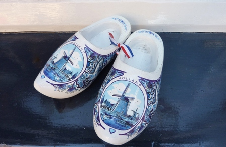 Wind mills painted on Delft blue wooden shoos of porcelain photo