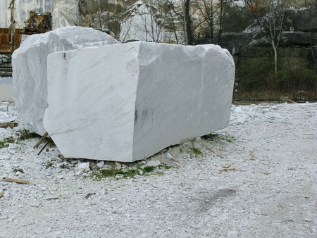 A block white marble in an open marble pit mine in Carara in Italy photo