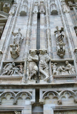 nascent: A detail of the sculptural decoration of the gothic cathedral of Milan in Italy Stock Photo