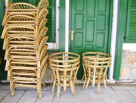 stackable: Stored chairs and tables at a terrace in the city  Stock Photo