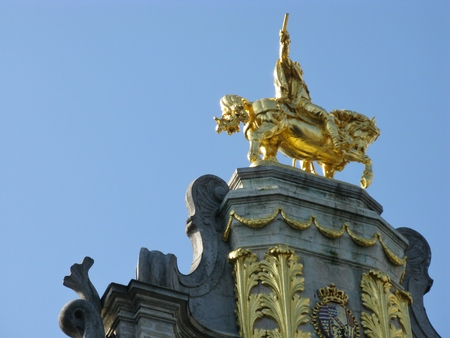 A golden horseman on his horse at the top of a guildhouse in Brussels in Belgium