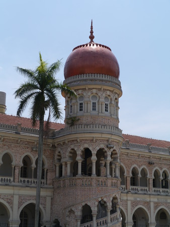 The tower of the Sultan Abdul Samad building  in front of the dataran Merdeka in Kuala Lumpur in Malaysia photo