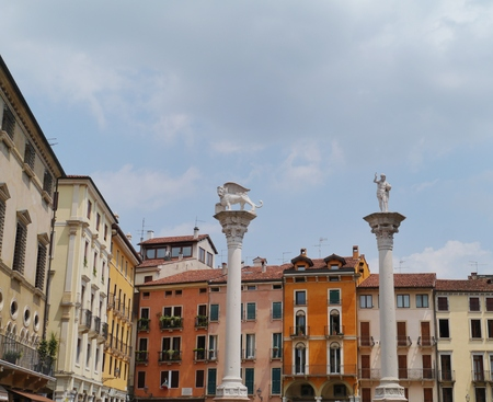 The Lion of St  Mark and Christ the Redeemer columns on the piazza dei signori in Vicenza in Italy photo