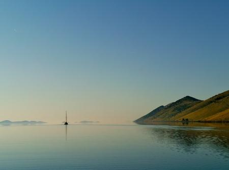 kornat: A sailing yacht leaving the Statival bay of the island Kornat in the Adriatic sea of Croatia