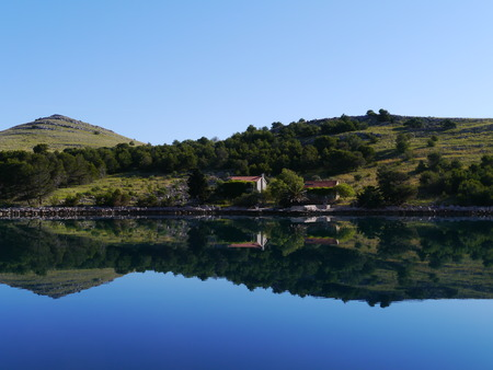 kornat: The early morning sun on the isle Kornat in the Statival bay Stock Photo