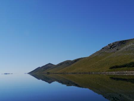 kornati national park: The early morning sun on the isle Kornat in the Statival bay of the Kornati national park in Croatia