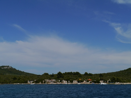 Fisherman houses at the bay of Prtljug on the island Ugljug in the Adriatic sea of Croatia