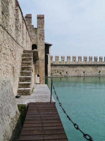 sirmione: The harbor of the Scaliger Castle in Sirmione in Italy Editorial