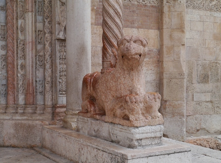 A lion of marble in front of the duomo Santa Maria Matricolare in Verona in Italy photo
