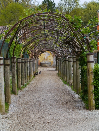 barbaro: An archway in perspective in the garden of  the villa Barbaro in Maser in the Veneto region of northern Italy Stock Photo