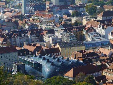 grazer: View of Graz in Austria  with the Grazer Kunsthaus or Graz Art Museum Editorial