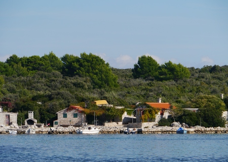Fisherman houses at the bay of Prtljug on the island Ugljug in the Adriatic sea of Croatia Stock Photo - 35291489