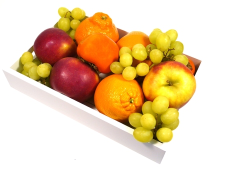 seasonally: Apples persimmon fruits minneolas grapes and oranges in a box Stock Photo