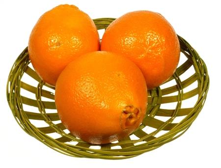 sappy: Three orange minneola tangelo citrus fruit over a white background