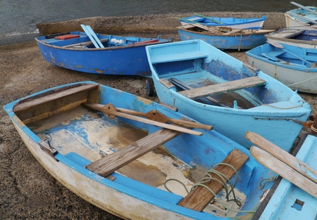 dinghies: Dinghies ashore in the new harbour of El Cotillao on the island Fuerteventura one of the Canary island belonging to Spain in the Atlantic Ocean