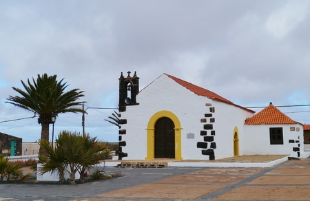 belonging: The white small church of the village Lajares on the island Fuerteventura one of the Canary islands belonging to Spain Stock Photo