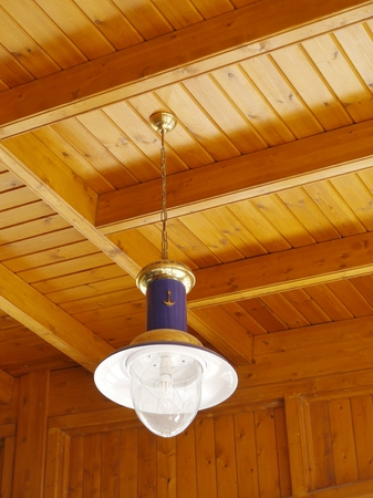 hanging lamp: Maritime hanging lamp at a wooden ceiling Stock Photo