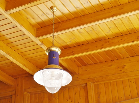 wooden  ceiling: Maritime hanging lamp at a wooden ceiling Stock Photo