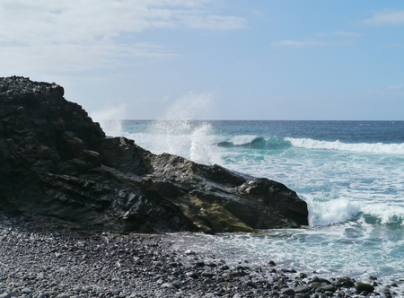 black pebbles: The coast with black pebbles of the Canary island  Fuerteventura Stock Photo
