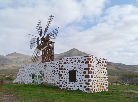 Historic wooden wind mill near the village Tefia on the Spanish island Fuerteventura one of the Canary islands in the Atlantic Ocean belonging to Spain Stock Photo