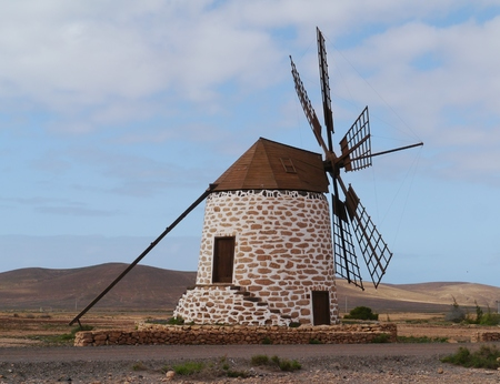 Historic wind mill of stone near the village Tefia on the Spanish island Fuerteventura one of the Canary islands in the Atlantic Ocean belonging to Spain