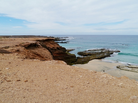 The rough coast of the Jandia nature park at the south end of the Canary Island Fuerteventura in Spain