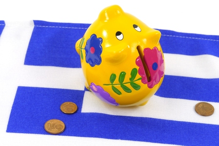 granting: An empty piggy bank on the Greek flag with small euro coins