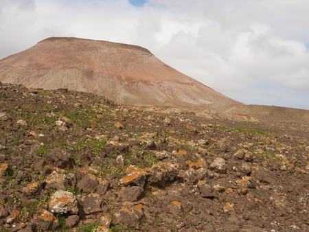 belonging: A colourful mountain landscape in the surroundings of Caldereta on Fuerteventura. This island is one of the Canary islands in the Atlantic  ocean belonging to Spain