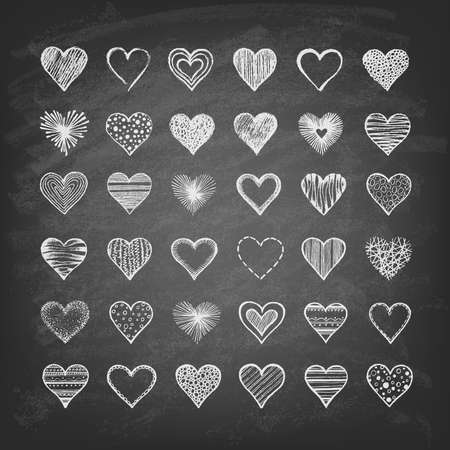 Set of hearts on the blackboard. Hand drawn. Vector illustration.