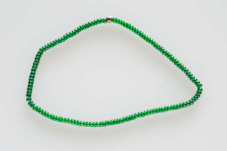 chaplet: green chaplet in shape on white background