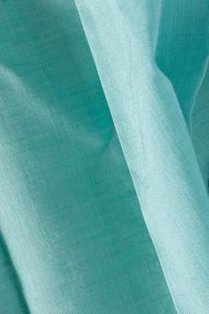 viewable: detail of pleated blue green fine woven cotton cloth