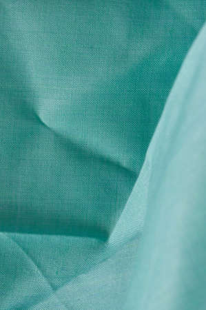 viewable: detail of creased turquoise fabric Stock Photo