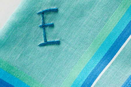 viewable: embroidered E on fine batiste cloth