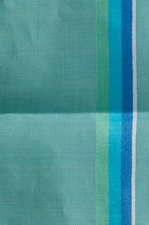 viewable: blue green stripes on cotton fabric with unfolded crease