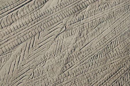 tire marks: tire marks on sandy soil