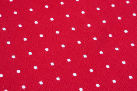 close p: embroidered white dots pattern on red fabric