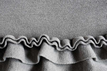 fluting: frills on grey jersey cloth