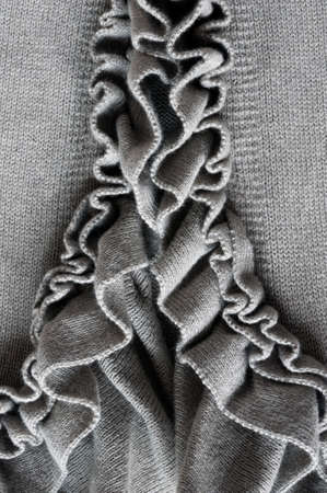 frill: nice frills on gray vest, close up Stock Photo