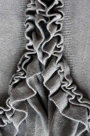 fluting: nice frills on gray vest, close up Stock Photo