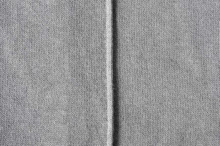 seam: slub seam on gray fabric Stock Photo
