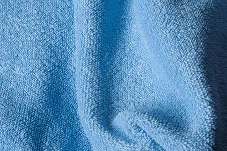 terrycloth: draped light blue terrycloth fabric
